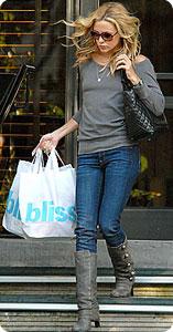 Kate Hudson en jean slim et bottes